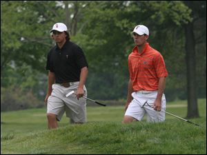 Oklahoma State's Ricky Fowler, left, and Florida's Billy Horschel walk to the green on No. 14 at