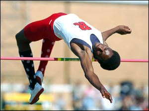 Erik Kynard of Rogers clears the bar at 6 feet, 7 inches to advance