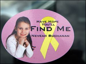 Stickers and flyers with Nevaeh Buchanan's photo are being used in the search for the missing 5-year-old. More than 100 law officers are aiding the investigation.