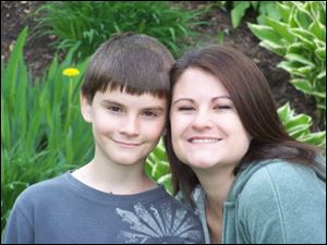 Austin Davenport, 11, with his mom, Emily Roman, a graduate of Mom's House.