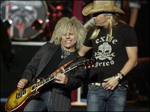 Poison's Bret Michaels, right, and C.C. DeVille performed at the Tonys.