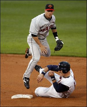 Toledo's Dusty Ryan slides into second base to try and prevent Rochester's Steve Tolleson from turning a double play.