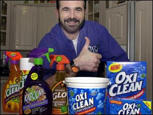 In this Dec. 6, 2002 file photo,TV pitchman Billy Mays poses with some of his cleaning products at his Palm Harbor, Fla., home. Tampa police say Mays, the television pitchman known for his boisterous hawking of products such as Orange Glo and OxiClean, has died. He was 50.