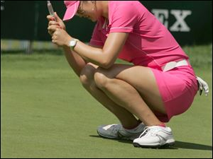 Michelle Wie reacts after missing a birdie putt on the 18th hole that would have given her a 63 Sunday.