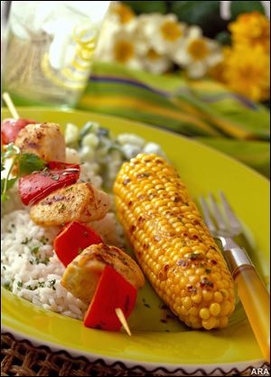 A spicy Hotlips Chili Butter adds flavor to your corn and chicken.