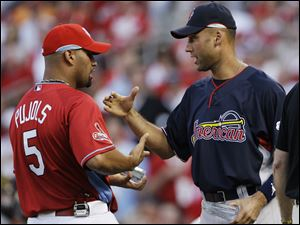 Albert Pujols of the Cardinals, left, and Derek Jeter of the Yankees congratulate each other after receiving awards for being the top All-Star vote-getters in their leagues.