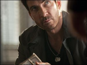 "In this image released by TNT, Dylan McDermott is shown in a scene from TNT's new undercover police drama, "" Dark Blue."""