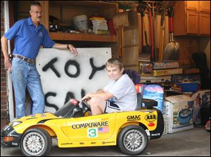 Zach McGuire, 11, is selling his toys to help his dad, Tom McGuire, left, a contractor who has been out of work since December.
