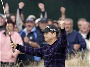 Tom Watson celebrates sinking a 30-foot birdie putt on the 16th hole. The 59-year-old has the lead heading into the final day.