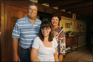 Tim and Terry Fejes of Martin, Ohio, with their 17-year-old daughter, Marlee Hope.