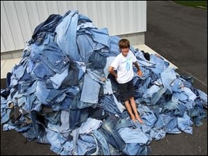 The 1,055 jeans Erek Hansen gathered will become insulation. With his aid, National Geographic Kids magazine set the Guinness World record for the largest collection of clothes for recycling.