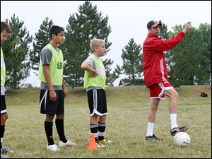 Mark Delaney, right, a former fullback for Aston Villa of the
