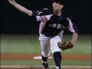 Toledo s Josh Rainwater throws a pitch in the second inning of last night s doubleheader against Scranton/Wilkes-Barre. The Yankees won the second game to split the doubleheader.