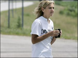 Cindy Koepfer has gone to a Clay Township field nearly every day since April to try to catch a scruffy stray.
