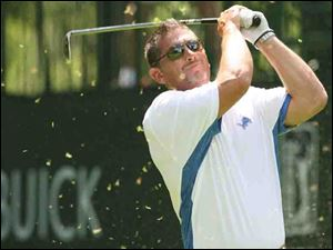 Jim Schwartz tees off at the Buick Open Pro-Am but today he will open training camp as head coach of the Detroit Lions.
