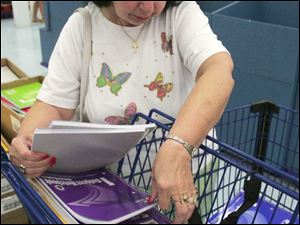 Toledoan Fay Bovee stocks up on notebooks priced at a nickel as she shops for school supplies for her grandchildren.