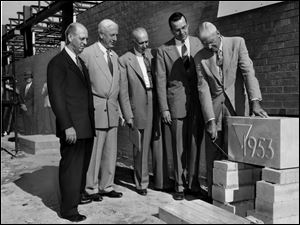 Toledo YMCA officials, from left, F.R. Findley, Harold Anderson, Paul Routsong, William Kuntz, and Dr. R.C. Young, were on hand on Sept. 28, 1953, when the cornerstone was laid for the organization's south branch. The facility opened the next year.