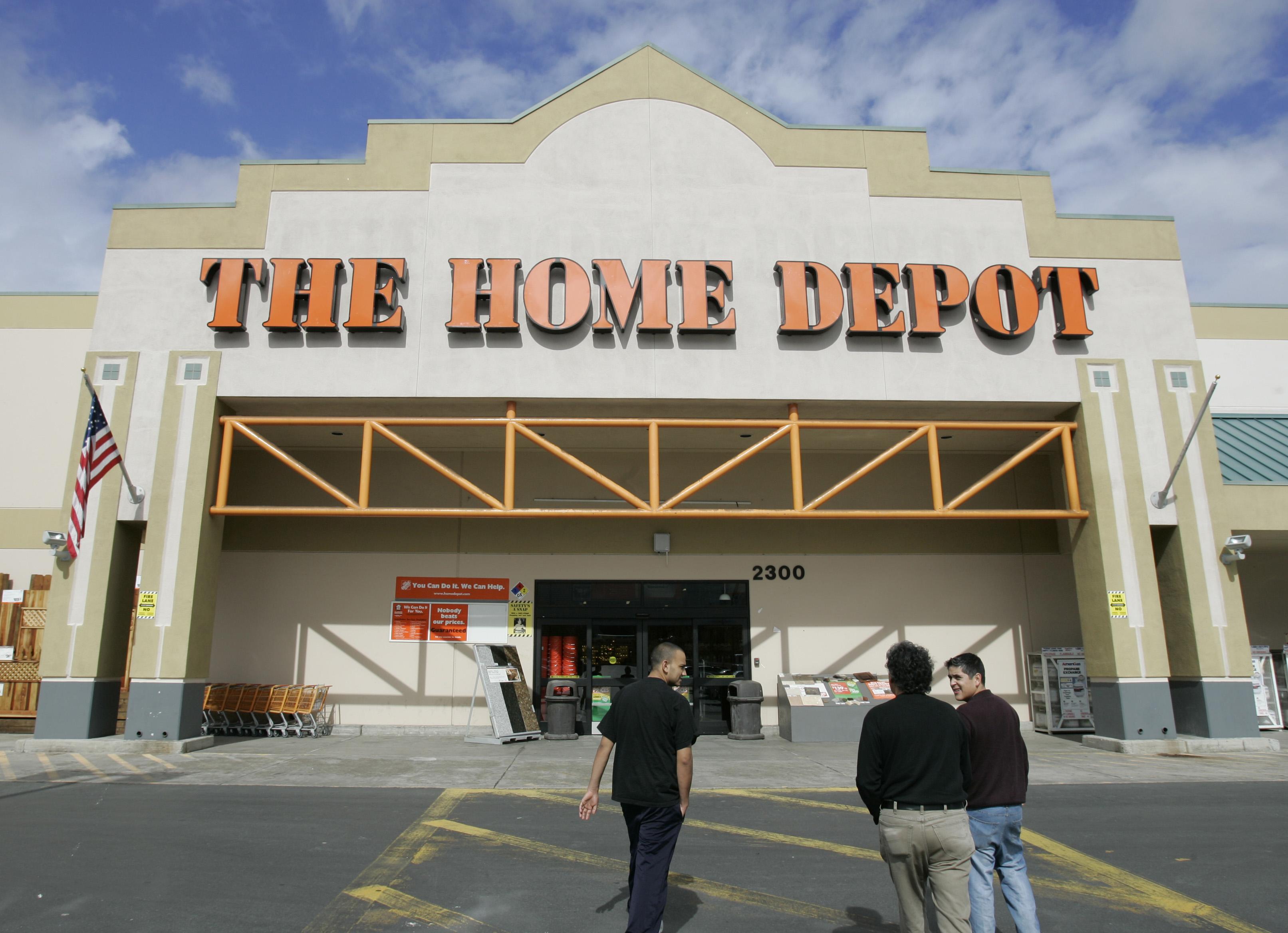 The front entry exterior of The Home Depot, a chain building .