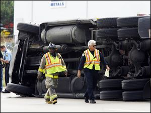 An overturned steel-hauler closed I-280 yesterday between I-75 and Manhattan Boulevard during rush hour, causing a long backup. Police said the rig s load shifted, causing the 3 p.m. accident.