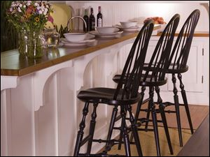 Photo courtesy of Caperton Furnitureworks. Just like the old masters, the spindles on this cherry counter stool run all the way through the bows and are secured with wood wedges.