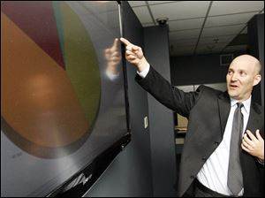 Matt Haschak, director of information security at Bowling Green State University, prepares for the influx of student computers.