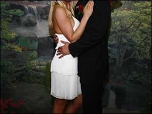 This photo provided by TMZ, shows Ryan Alexander Jenkins and Jasmine Fiore's March 18, 2009 wedding in Las Vegas. Jenkins, a reality TV contestant, is charged with killing his wife, a former swimsuit model.