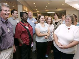 A group of 24 employees at Oakleaf Village of Toledo won $250,000 in Tuesday night s Mega Millions drawing. Front row, from left, are David Moyer, Gussie Wilson, Alison Ostrosky, and Jan Krueger.