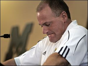Michigan coach Rich Rodriguez was visibly upset meeting the media Monday, saying he cares about the welfare of his players.