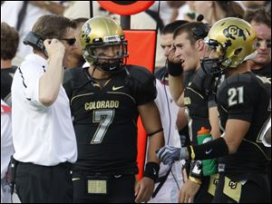 Colorado coach Dan Hawkins talks with quarterback Cody Hawkins, his son, duiring their game against Colorado State.