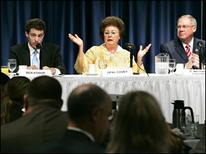 Opal Covey, center, has the floor as Democrat Ben Konop, left, and Independent D. Michael Collins listen during Friday's debate, the last scheduled before Tuesday's primary election, which will reduce the number of Toledo mayoral candidates to two.