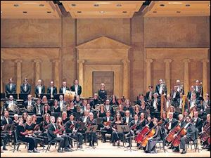 The Toledo Symphony, pictured here in the Peristyle of the Toledo Museum of Art,