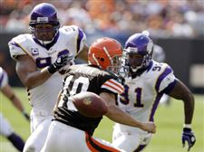 New-year-same-story-Favre-Peterson-torch-Browns