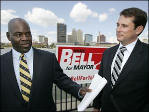 Toledo mayoral candidate Mike Bell, left, with associate professor Steven Cady of Bowling Green State University discusses an assessment to find what's working in Toledo and what's not.