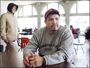 Alejandro Dominguez, 41, of East Toledo, used to work in construction but was sidelined by a back injury. 'I just put my faith in God,' he said yesterday at Cherry Street Ministries.