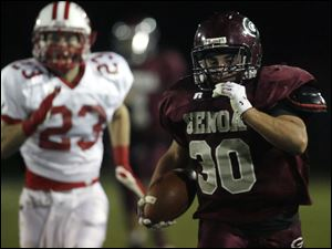 Genoa's Greg Hillabrand pulls away from Eastwood's Jake Rogers on a 75-yard touchdown run. Hillabrand had 181 yards rushing.