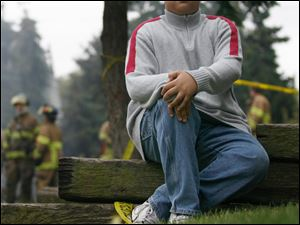 Tyler Grayson, 14, ran through the structure next door to the blaze, pounding on doors and trying to rouse residents.