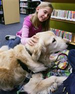 Rossford-kids-read-and-dogs-sit-listen-patiently