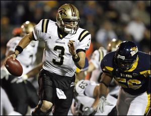 Western Michigan quarterback Tim Hiller throws downfield during the second quarter. He moved into a tie for third place in Mid-American Conference history with 87 career touchdown passes.