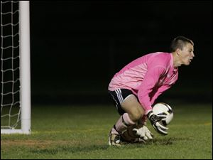 Perrysburg goalkeeper Jeremy Ashley blocks a shot. Ashley has allowed less than one goal per game.