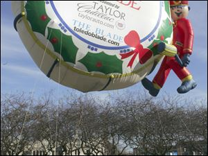 Taylor Automotive Group's helium-filled balloon makes its way along downtown Toledo streets during the 2008 parade.