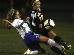 Anthony Wayne's Anna Coffman, left, and Northview's Chelsea Nye battle for the ball yesterday in girls Division I district soccer semifinal. The Wildcats defeated the Generals 2-1 in OT.