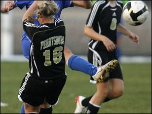 St. Ursula's Katie David gets her foot into the ball as Perrysburg's Kelsey Draper (16) attempts to fend off David's kick in yesterday's district semifinal in Sylvania. Anthony Wayne's Anna Coffman, left, and Northview's Chelsea Nye battle for the ball yesterday in girls Division I district soccer semifinal. The Wildcats defeated the Generals 2-1 in OT.