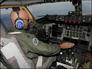 Capt. Rob Cruea guides a KC-135 tanker toward a refueling rendezvous with F-16s from Toledo. Captain Cruea is with the 121st Air Refueling Wing.