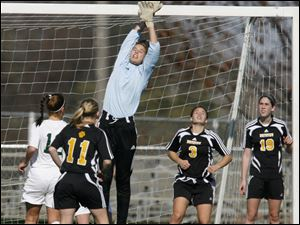 Northview's Jessica Jessing goes high to make a save in a regional final against fourth-ranked Medina. Jessing made several spectacular plays, but it wasn't enough as the Wildcats were stymied on offense. Medina has only lost one time all season and has yet to surrender a tournament goal. Northview finishes 13-6-3. 