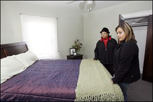Slug:CTY tour08p                         Date 11/7/2009           The Blade/ Amy E. Voigt                   Location: Toledo, Ohio  CAPTION:  Lisa Crawford, left, and Nicole Reno, right, look at the master bedroom at 2313 Portsmouth during the Tour Toledo Preview of Homes tour that was open to the public on November 7, 2009.