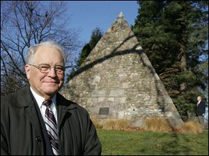 Fred Folger has written 'Buried Treasures of Toledo: Notable People Laid to Rest in Historic Woodlawn Cemetery.' It includes the story of the monument to John Gunckel, in the background.