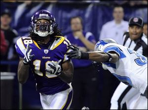 Minnesota's Sidney Rice snags a 56-yard pass from Brett Favre. He had 201 yards receiving.