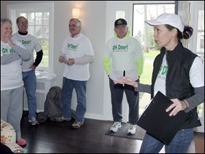 Margaret Rodriguez, right, talks to other opponents of the deer cull, all wearing their opposition T-shirts. From left are Cathy Appleby, Michael Eisenstodt, Jim Jenkins, and Clyde Appleby. Retired Ohio Supreme Court Justice Alice Robie Resnick shows deer repellents she uses in her yard in Ottawa Hills. She opposes the village proposal to hire a firm to kill up to 50 deer.