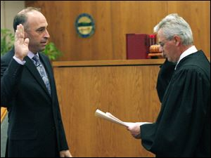 Slug: CTY oregon30p                       Date 11/29/2009           The Blade/ Amy E. Voigt                   Location: Oregon,  Ohio  CAPTION:   Judge Jeffrey Keller of Oregon Muncipal Court, right,  swears-in ceremony Mayor Michael Seferian, left, during a ceremony  on November 29, 2009.  There will be  a farewell luncheon and open house for Marge Brown, who was mayor of Oregon for eight years, at 12:30 p.m. Monday in City Council Chambers, 5330 Seaman Road.