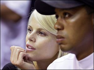 Tiger Woods says his wife, Elin, seen with him at a basketball game in Orlando in June, 'acted courageously when she saw I was hurt and in trouble. She was the first person to help me.'